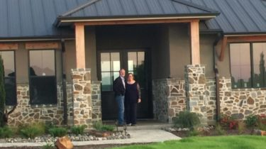 Full-time residents Mark and Jacque Meadows from McKinney, Texas pose at their new Beacon Hill home in Kemp, Tx.